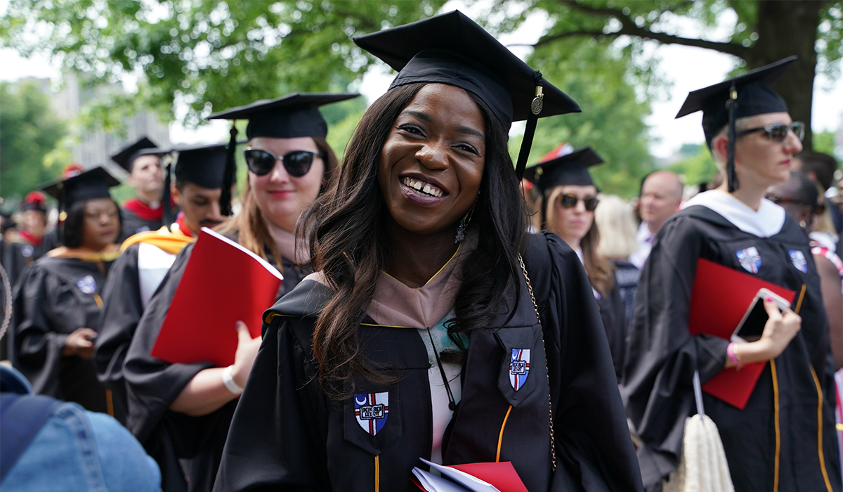 Female student smiling at Commencement